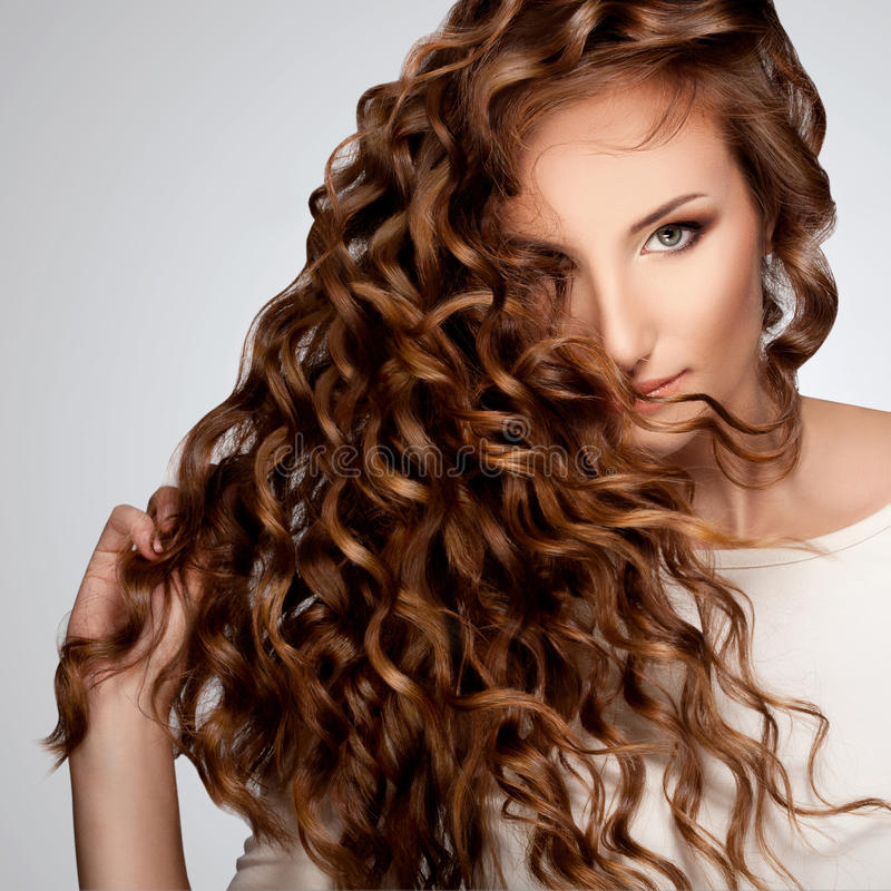 Woman with Beautiful Curly Hair. Beautiful Woman with Curly Long Hair. High quality image stock photography