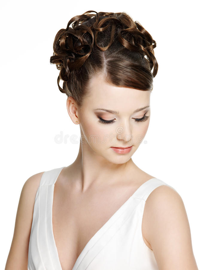 Woman with beautiful hairstyle and brown make-up stock images