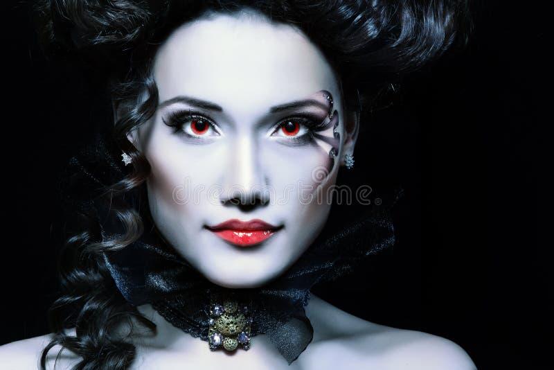 Woman beautiful halloween vampire baroque aristocrat. Over black background royalty free stock photography