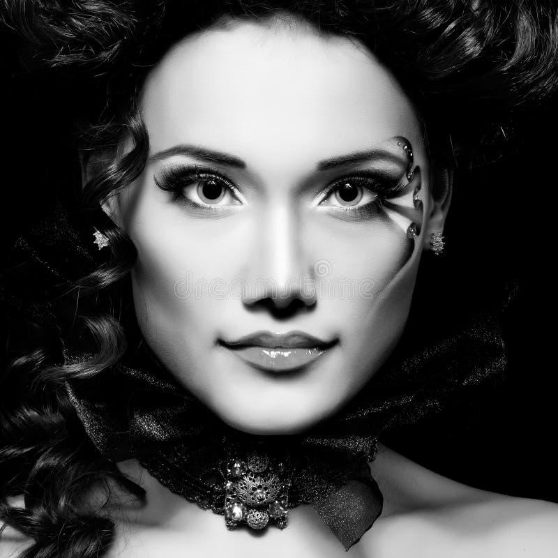 Woman beautiful halloween vampire baroque aristocrat. Over black background royalty free stock photos