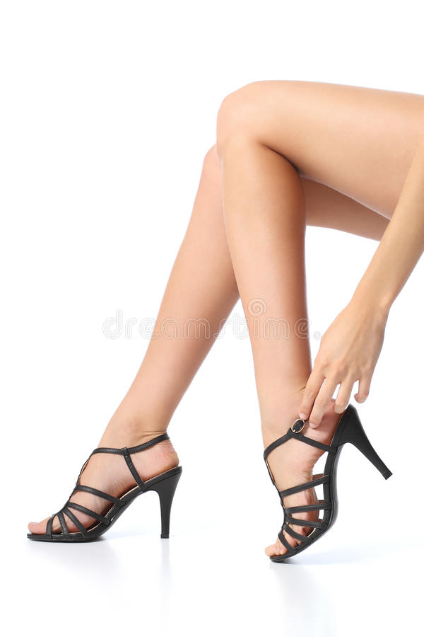 Woman with beautiful legs touching the heel of the foot. Isolated on a white background stock photos