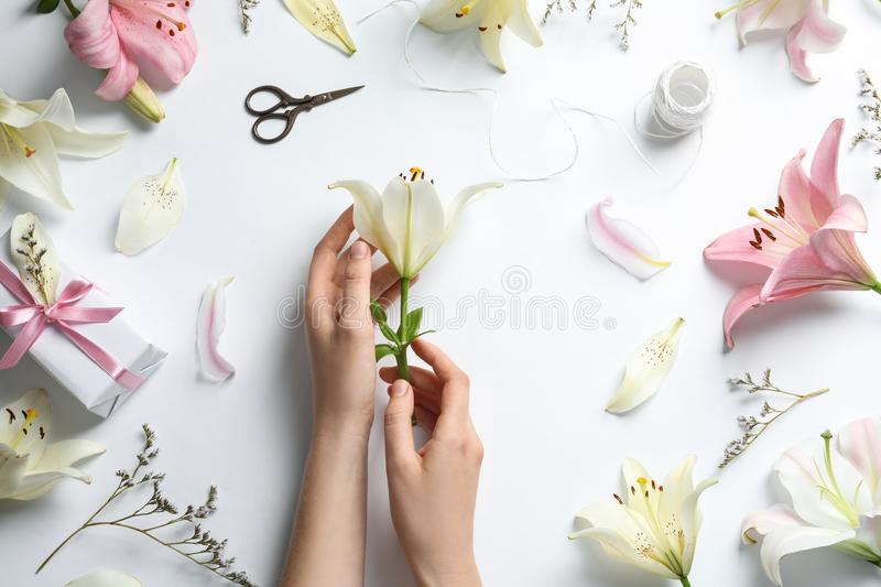 Woman with beautiful lily flower stock photography