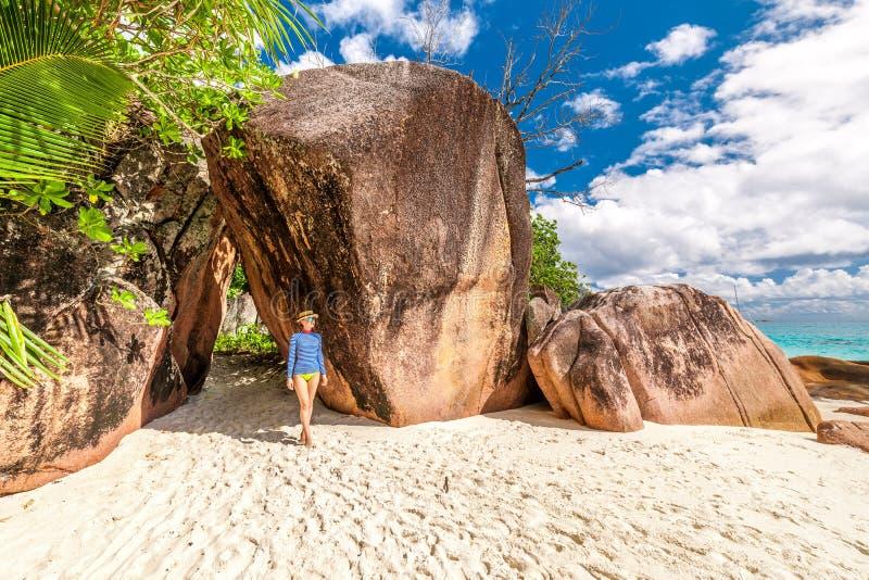 Woman at beautiful Seychelles beach wearing rash guard. Woman at beautiful beach wearing rash guard. Seychelles, Praslin, Anse Lazio stock photography
