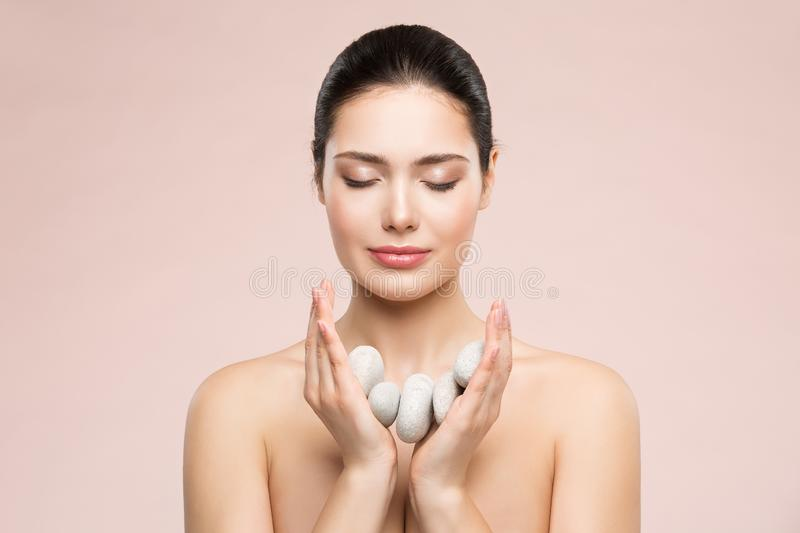 Woman Beauty Care and Treatment, Beautiful Model Holding Massage Stones in Hands, Happy Girl Health Dreams royalty free stock photography