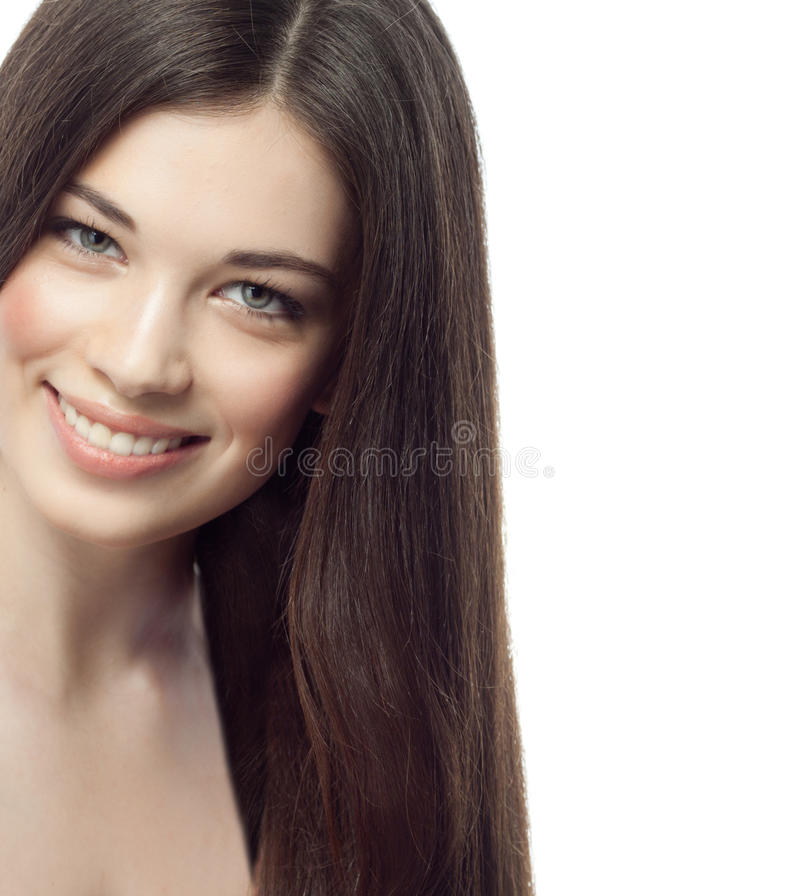 Woman beauty. Closeup portrait of attractive caucasian smiling woman brunette isolated on white studio shot lips toothy smile face hair head and shoulders royalty free stock image