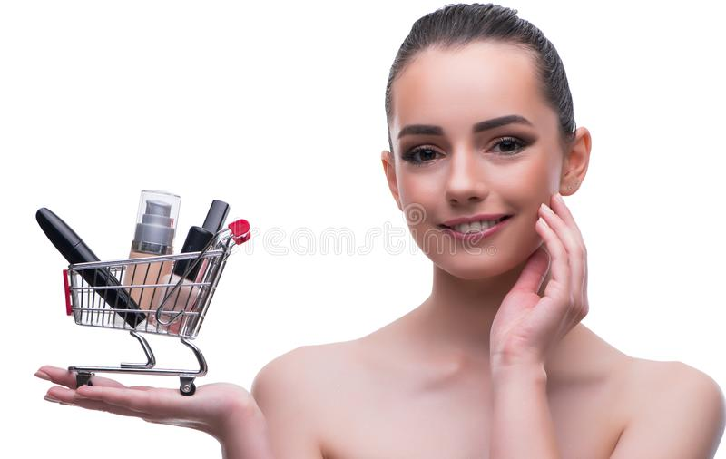 Woman in beauty concept with make up holding shopping cart royalty free stock photo