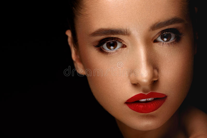 Woman With Beauty Face And Beautiful Makeup. Cosmetics Concept. Fashion Makeup Model. Portrait Of Beautiful Glamourous Young Woman With Perfect Makeup, Long royalty free stock photography