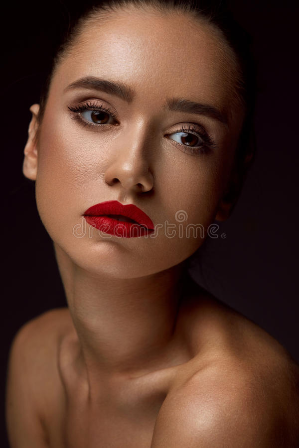 Woman With Beauty Face And Beautiful Makeup. Cosmetics Concept. Fashion Makeup Model. Portrait Of Beautiful Glamourous Young Woman With Perfect Makeup, Long royalty free stock image