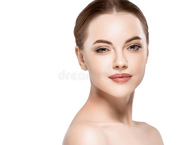 Woman beauty face portrait isolated on white with healthy skin. Studio shot stock photography