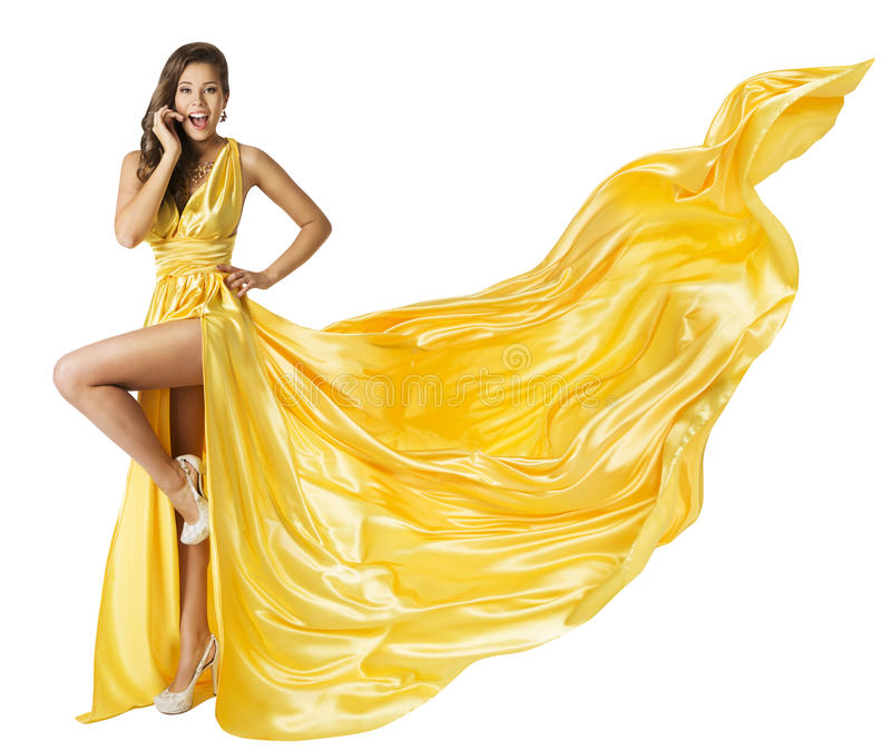 Woman Beauty Fashion Dress, Beautiful Girl In Flying Yellow Fluttering Gown, Standing on One Leg High Heels, Fabric Cloth Waving. Woman Beauty Fashion Dress royalty free stock photo