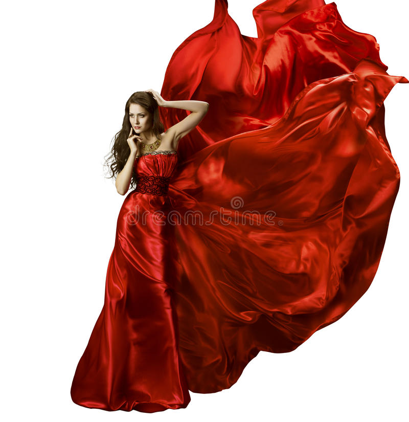 Woman Beauty Fashion Dress, Girl In Red Elegant Silk Gown Waving. Fabric, Model In Long Fluttering Cloth On Wind, Isolated Over White Background royalty free stock photo