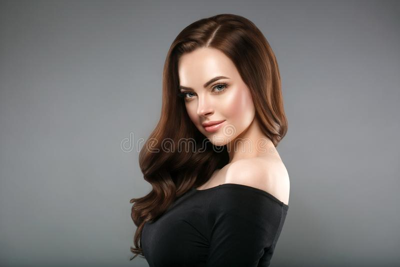 Woman beauty healthy skin and hairstyle, brunette with long hair. Over dark background female portrait. Studio shot stock images