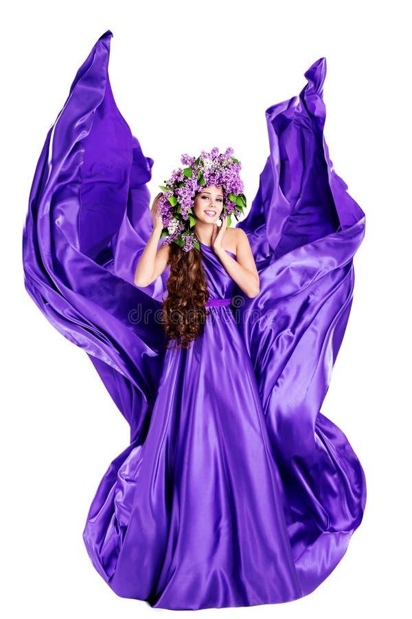 Woman Beauty Lilac Wreath, Fluttering Silk Purple Dress, Beautiful Fashion Gown Waving on White stock image