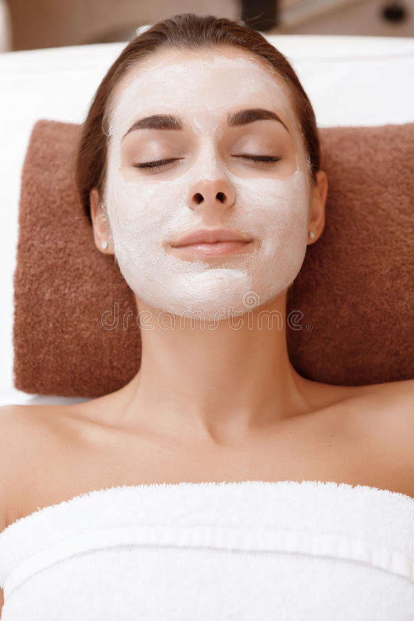 Woman with a beauty mask royalty free stock photography