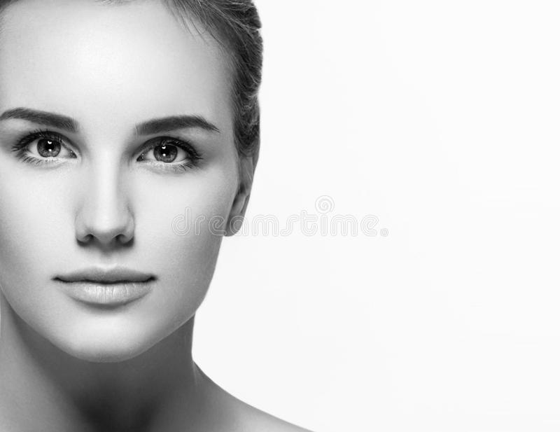 Woman beauty portrait. isolated on white. close up female face. Black and white royalty free stock images