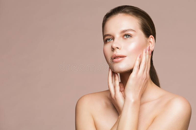 Woman Beauty Portrait, Model Touching Face, Beautiful Girl Makeup and Nails Treatment. Over beige studio background stock photos