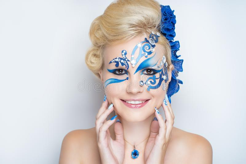Woman blue art make up royalty free stock photo