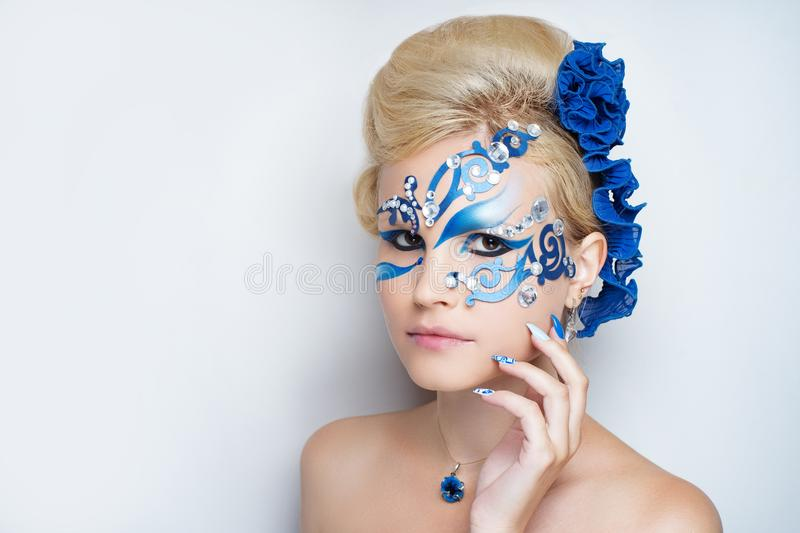 Woman blue art make up stock photos