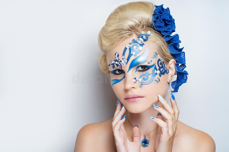 Woman blue art make up stock photo