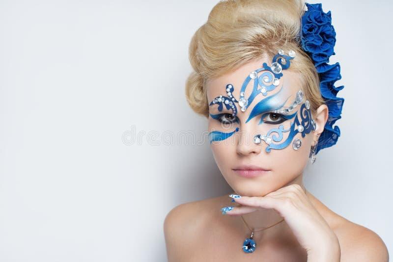 Woman blue art make up stock photo