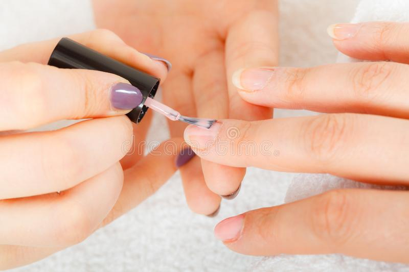 Woman in beauty salon getting manicure done stock image