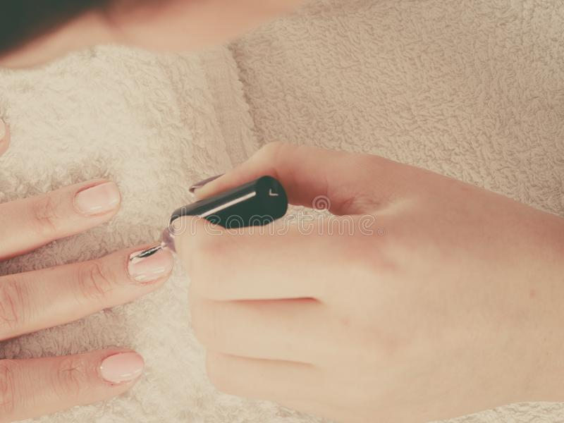 Woman in beauty salon getting manicure done royalty free stock image