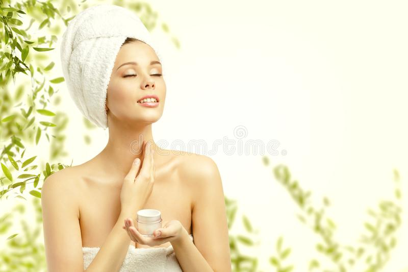 Woman Beauty Skin Care, Model Applying Moisturizer to Neck. Young Girl Moisturizing Cosmetic Cream on Green Eco Background stock photos