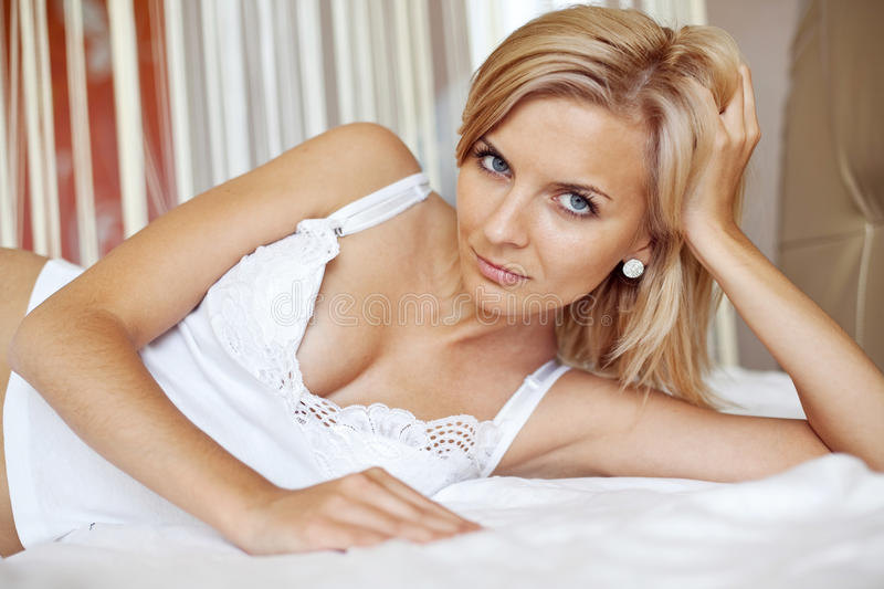 Download Woman On Bed Royalty Free Stock Photography - Image: 23660267
