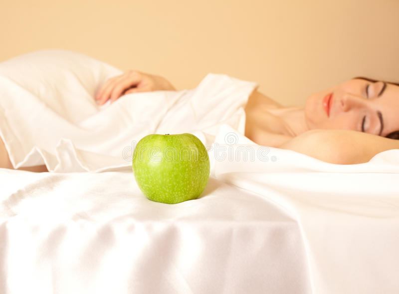 Download Woman In Bed With Apple (focus On Apple) Stock Photo - Image of care, clean: 23528670