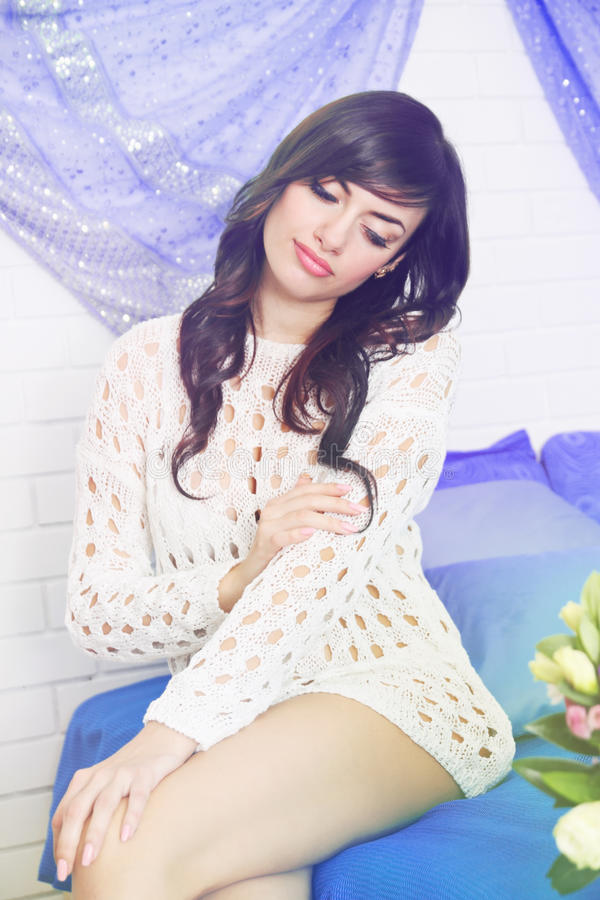 Woman on the bed with a flower royalty free stock images