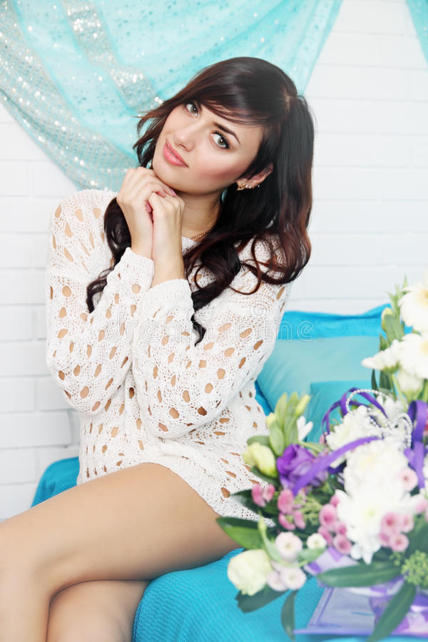 Woman on the bed with a flower stock images