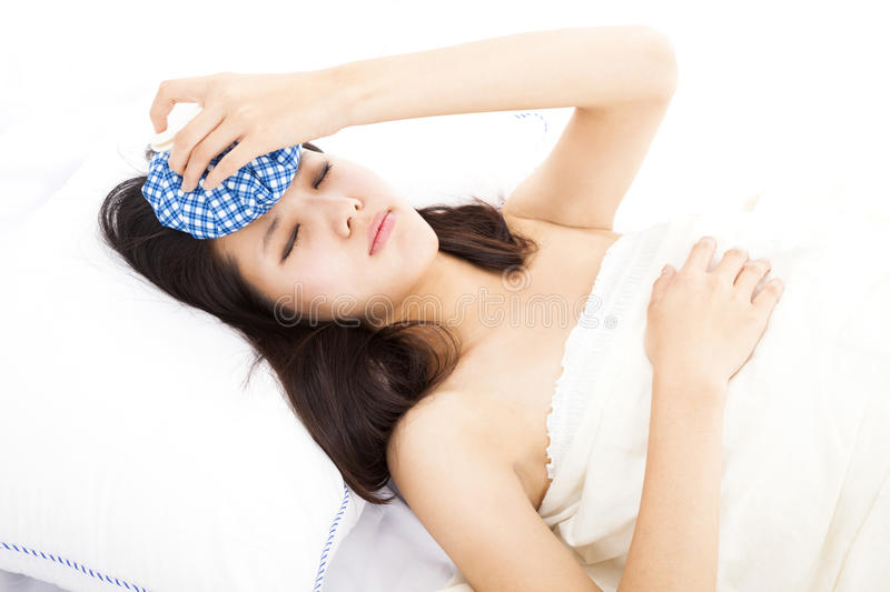 Woman in bed with headache royalty free stock photo