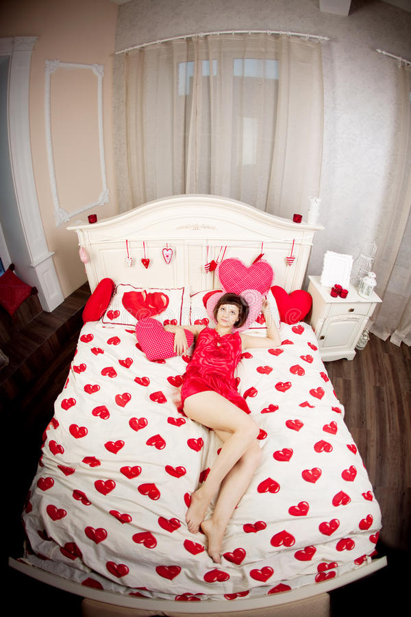 Download Woman in bed with hearts stock photo. Image of brunette - 25321284