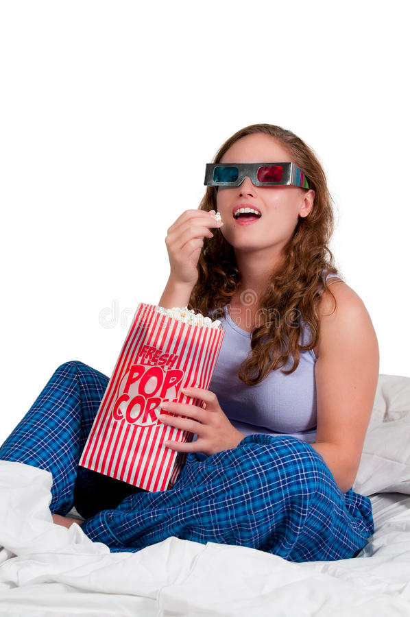 Woman in bed with popcorn royalty free stock images