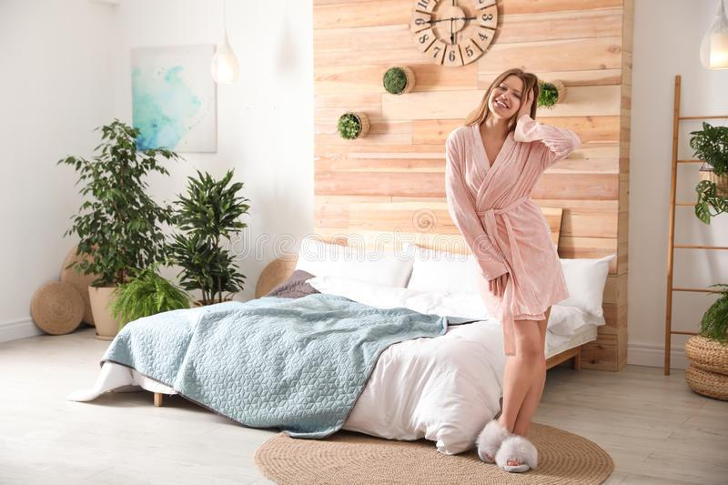 Woman in bedroom with plants. Home design ideas stock images