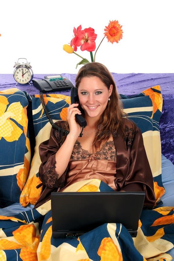 Woman bedroom laptop royalty free stock photo