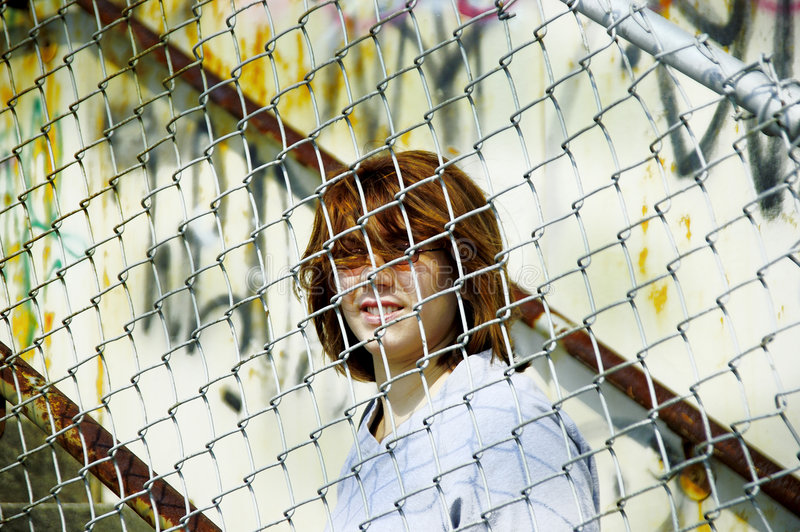 Woman Behind Fence royalty free stock image