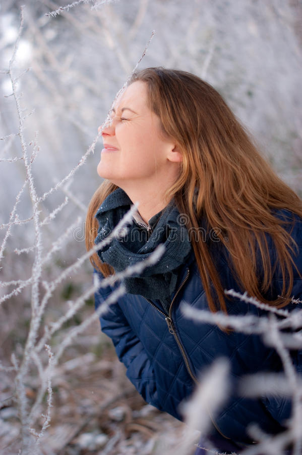 Download Woman behind frosty twigs stock image. Image of jacket - 18122241