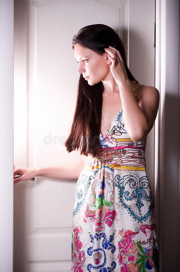 Woman behind opened white door royalty free stock photos