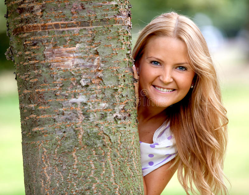 Download Woman behind a tree stock image. Image of portrait, girl - 10854273