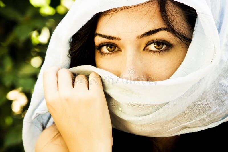 Woman behind veil royalty free stock photo