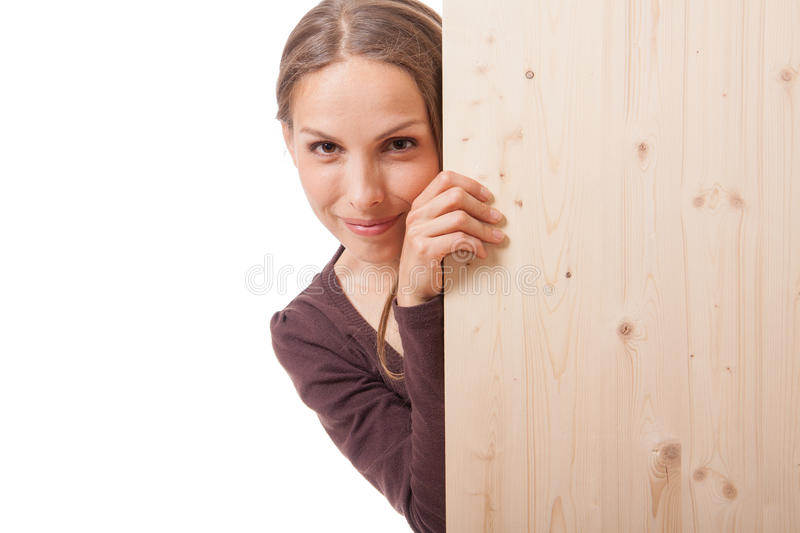 Woman behind a wooden board royalty free stock photos