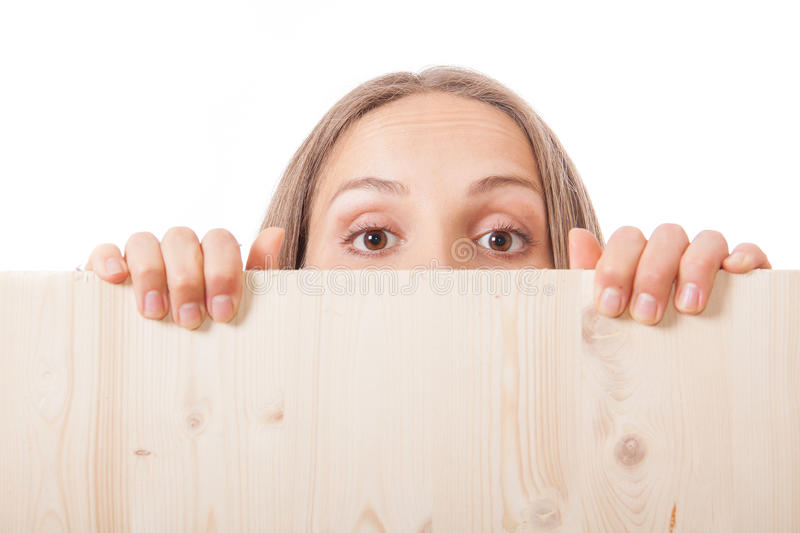 Woman behind a wooden board royalty free stock image