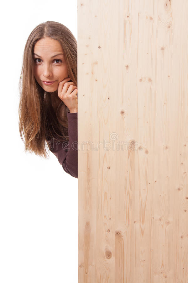 Woman behind a wooden board stock images