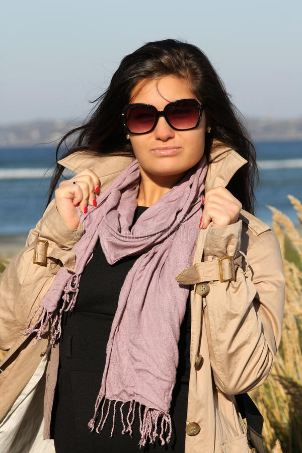 Download Woman In Beige Autumn Coat Standing At Beach Stock Photo - Image: 16436618
