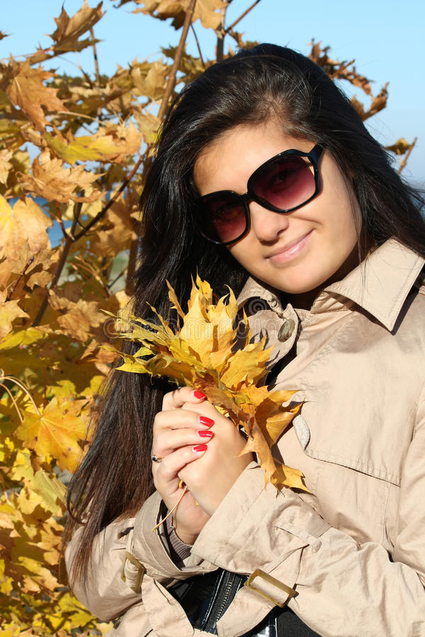 Download Woman In Beige Coat With Golden Leafage Stock Image - Image: 16437139