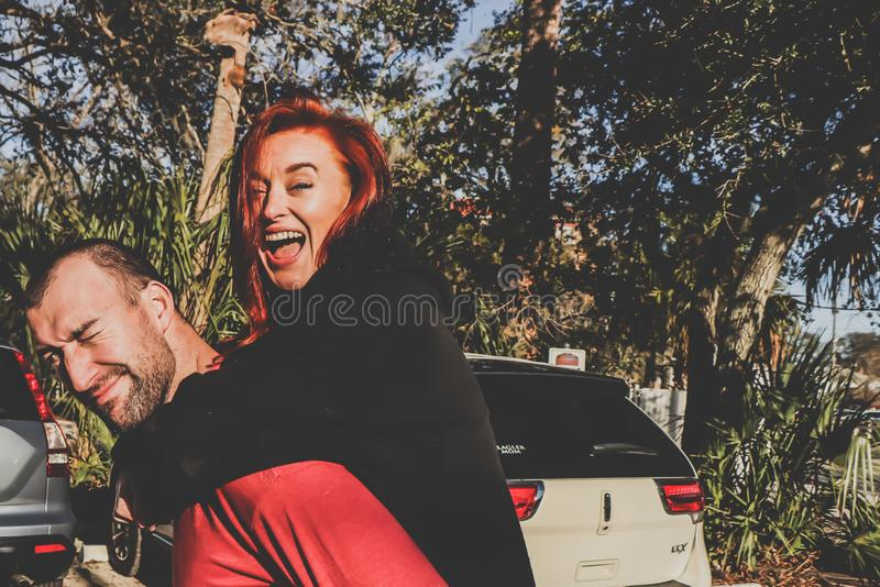 Woman Being Carried by Man Outdoor stock photography