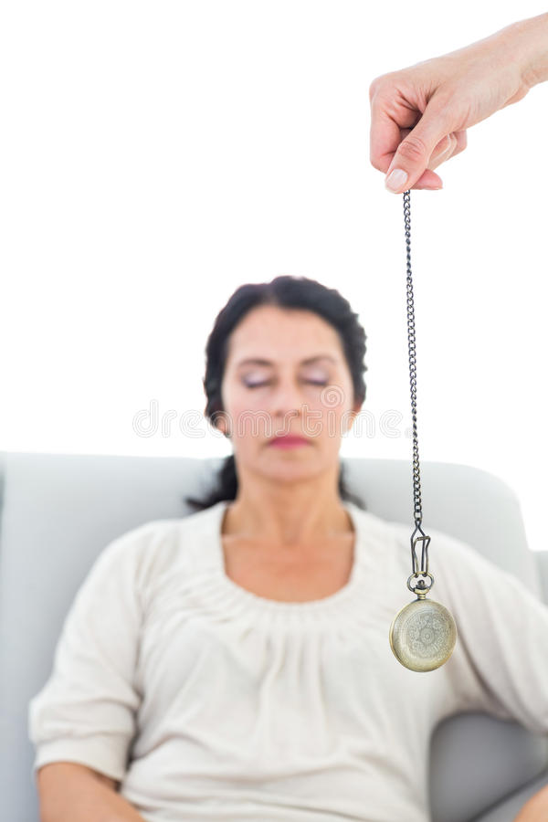 Woman being hypnotized royalty free stock photo