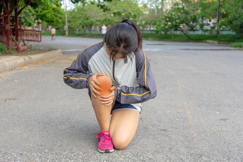 Woman being Injuries to the leg muscles which are dangerous to the athlete from exercise that creates pain after outdoor sports royalty free stock photo