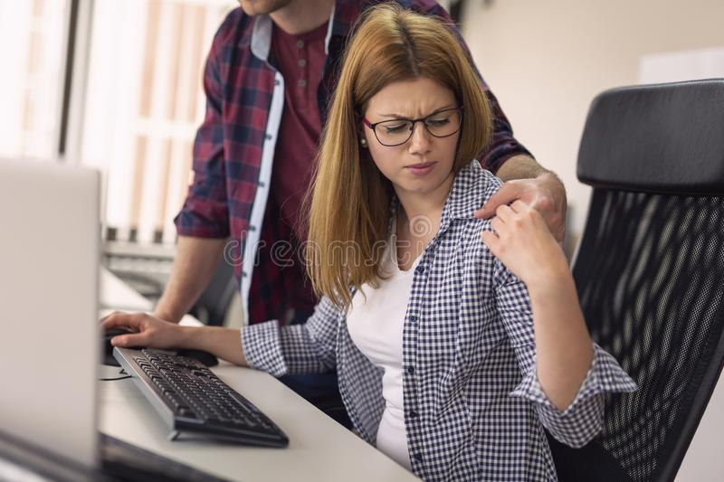 Woman being sexually harassed at work royalty free stock image